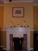 Farrow and Ball yellows in fireplace feature wall