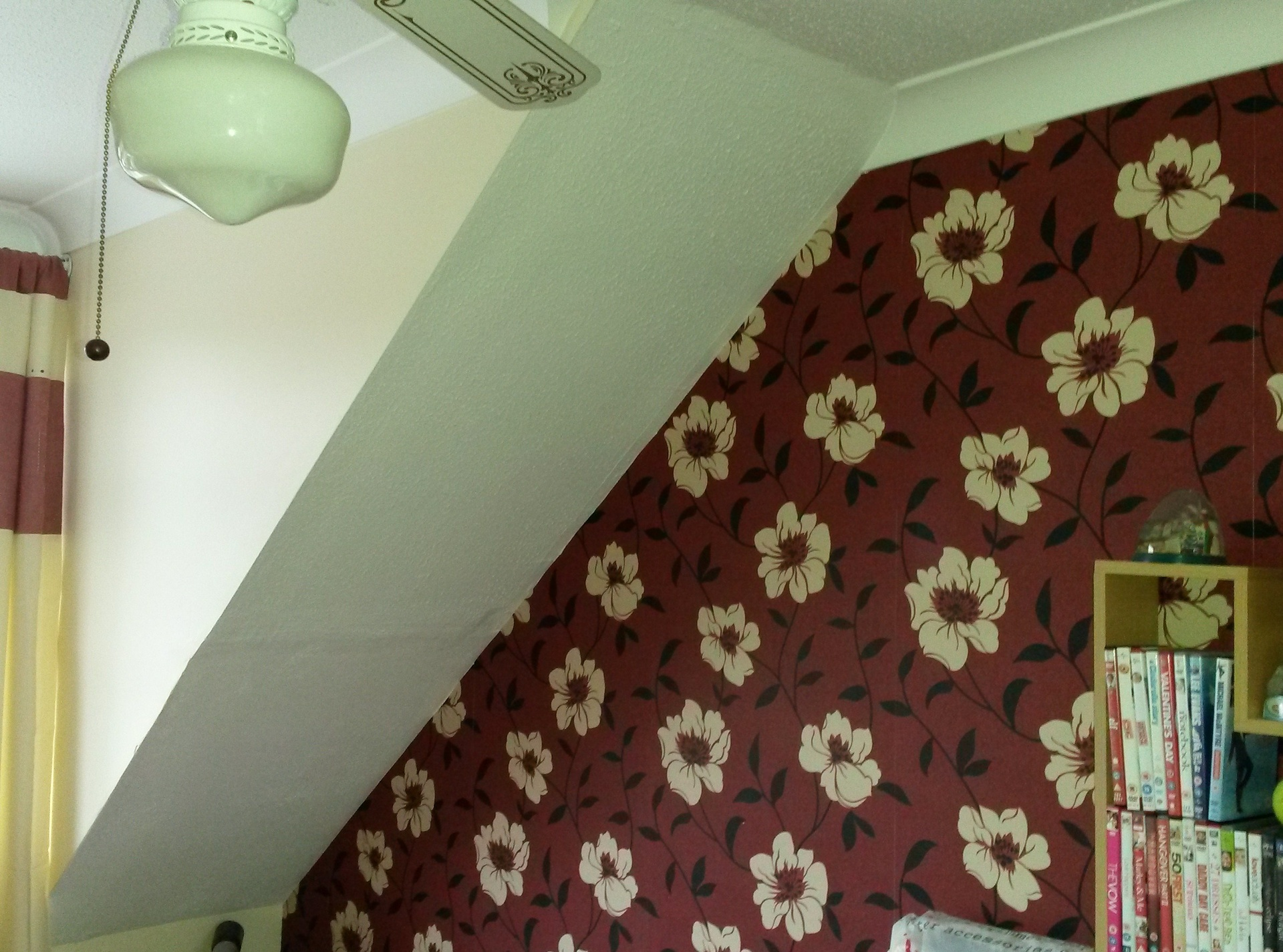 Warm red flowery wallpaper to warm up a bedroom.